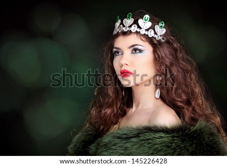 Beautiful woman luxury portrait with long hair in fur coat. Jewelry and Beauty. Fashion art photo - stock photo