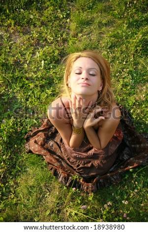 Beautiful woman lying down in summertime. - stock photo