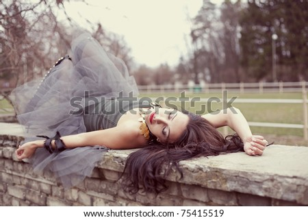 beautiful woman lying in the park - stock photo