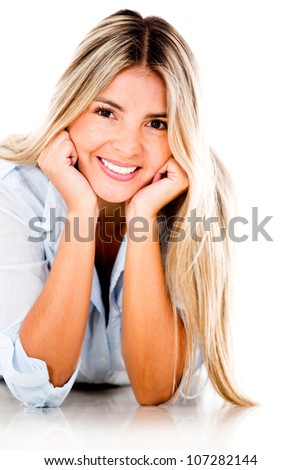 Beautiful woman lying on the floor and smiling - isolated over white background - stock photo