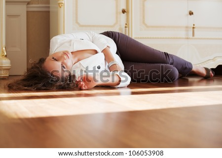 Beautiful woman lying on the parquet floor