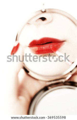 beautiful woman make up with a hand mirror - stock photo
