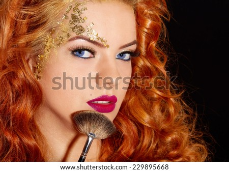 Beautiful woman makeup brush  - stock photo