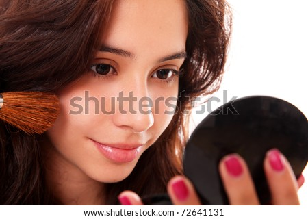 beautiful woman makeup her face over white background - stock photo