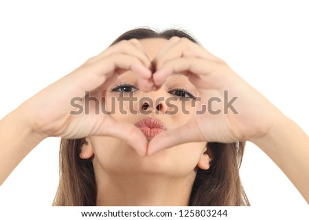 Beautiful woman making a heart shape with her hands on a white isolated background - stock photo