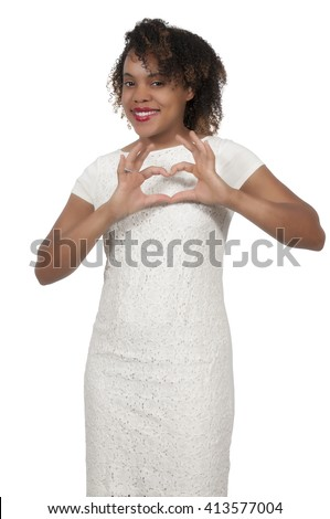 Beautiful woman making a heart symbol with her hands - stock photo