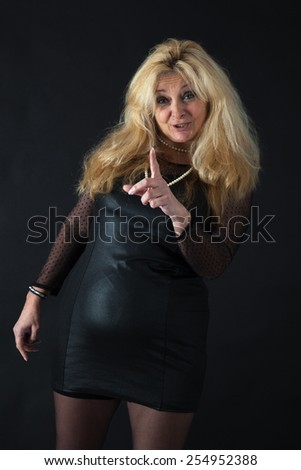 Beautiful woman man doing different expressions in different sets of clothes: drunk - stock photo
