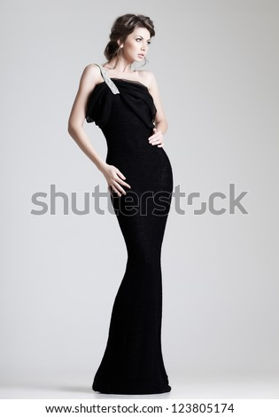 beautiful woman model posing in elegant dress in the studio - stock photo