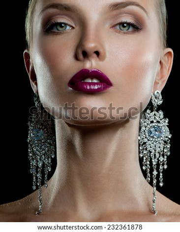 beautiful woman model with professional makeup, in jewelry - stock photo