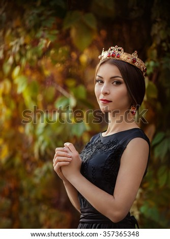 Beautiful woman model with professional makeup, in jewelry. Golden crown in style D&G - stock photo