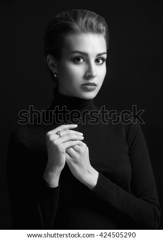 beautiful woman.monochrome beauty portrait of a young brunette model in a black roll neck jumper.sensual girl with short hair - stock photo
