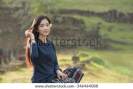 Beautiful woman new generation woman lao in native dress at Pakse South Laos. - stock photo