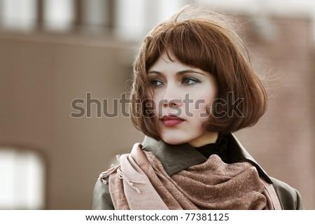 Beautiful woman on a city street - stock photo