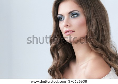 Beautiful woman on a gray background