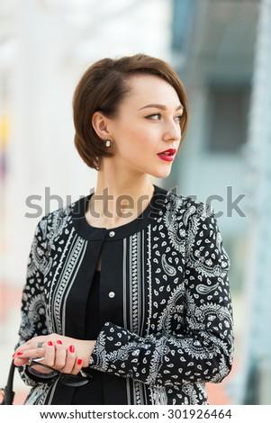 beautiful woman on bridge - stock photo