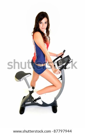 beautiful woman on excercise bike isolated on white background