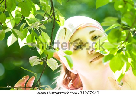 beautiful woman on green leaf