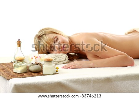 Beautiful woman on massage table isolated on white