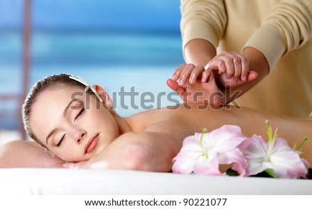 Beautiful woman on spa massage for back  - nature background