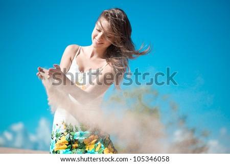 Beautiful woman on the beach - stock photo