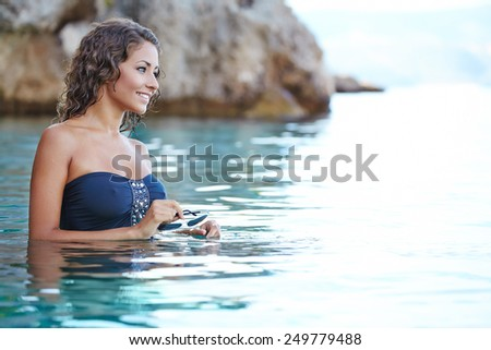 Beautiful woman on the beach.  - stock photo