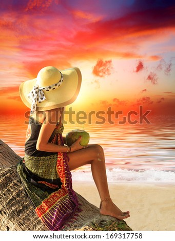 Beautiful woman on the beach at sunset in Thailand. - stock photo