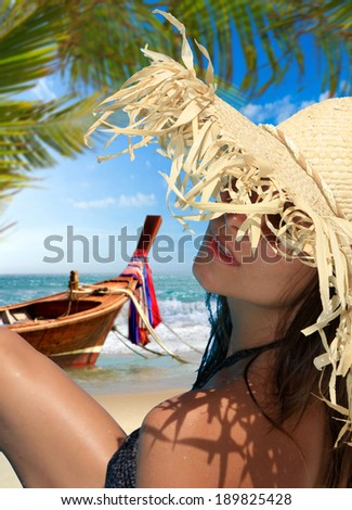 Beautiful woman on the beach in Thailand. - stock photo