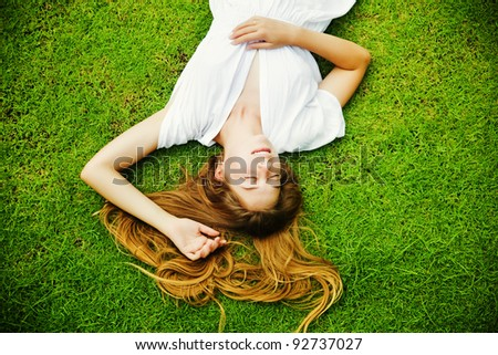 beautiful woman on the grass - stock photo