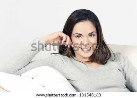 Beautiful woman on the sofa at home - stock photo