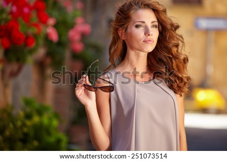 Beautiful woman on the streets of the old Italian town - stock photo