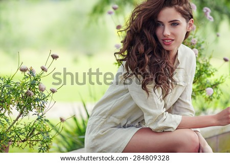 Beautiful woman on the terrace of an Italian country garden - stock photo