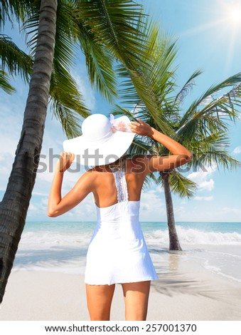 Beautiful woman on the tropical beach - stock photo