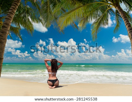 Beautiful woman on the Tropical beach of Lamai in Koh Samui island in Thailand - stock photo