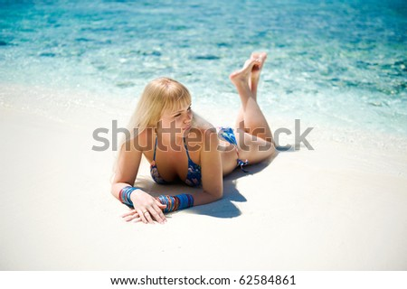 Beautiful woman on the tropical white beach