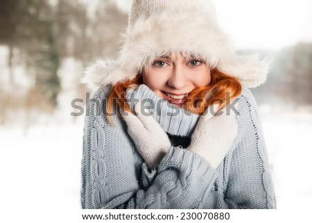 Beautiful woman on the winter background - stock photo