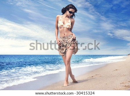 Beautiful woman on tropical beach - stock photo
