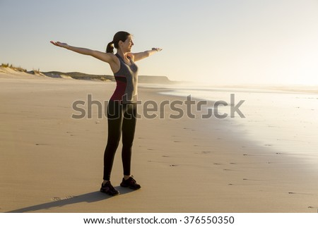Beautiful woman open her arms and relaxing after her exsercise - stock photo