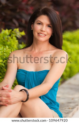 Beautiful woman outdoor portrait. - stock photo