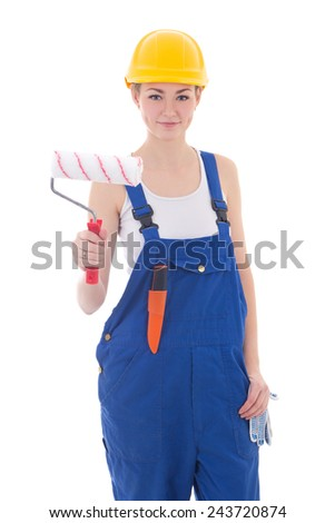 beautiful woman painter in blue coveralls and yellow helmet isolated on white background - stock photo