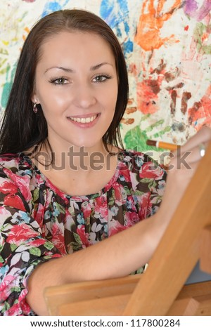 Beautiful woman painting - stock photo