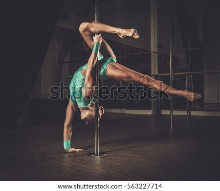 stock-photo-beautiful-woman-performing-pole-dance-on-pole-563227714.jpg