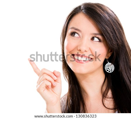 Beautiful woman pointing a great idea - isolated over a white background