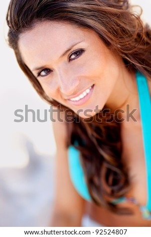 Beautiful woman portrait at the beach smiling - stock photo