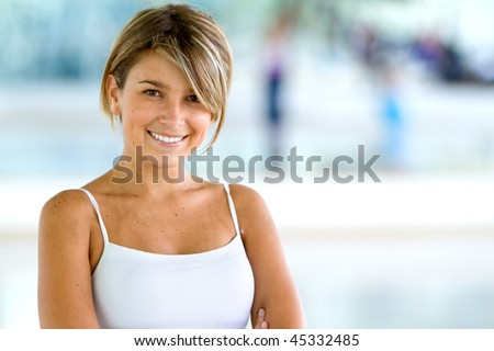 Beautiful woman portrait at the gym smiling - stock photo