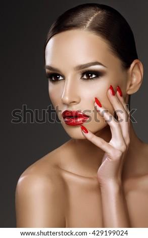 Beautiful woman portrait, beauty on dark background, red nails - stock photo