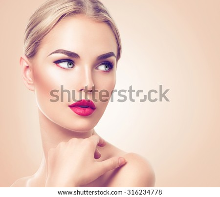 Beautiful woman portrait. Beauty Spa girl with perfect fresh skin. Pure Beauty blonde model with holiday makeup. Youth and Skin Care Concept. Studio shot - stock photo