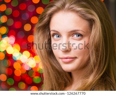 Woman portrait christmas lights at the background stock photo