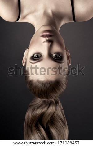 Beautiful Woman Portrait. Head over heels.
