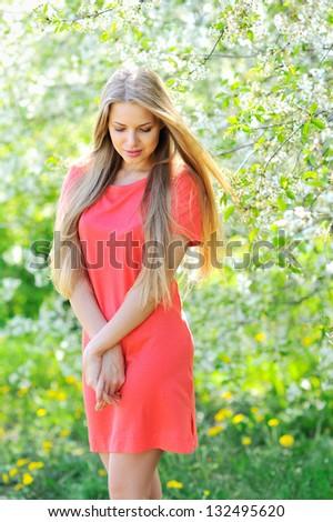 Beautiful woman portrait in nature - stock photo