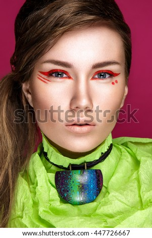 Beautiful woman portrait isolated on pink background. Young lady posing with red eyeshadow.